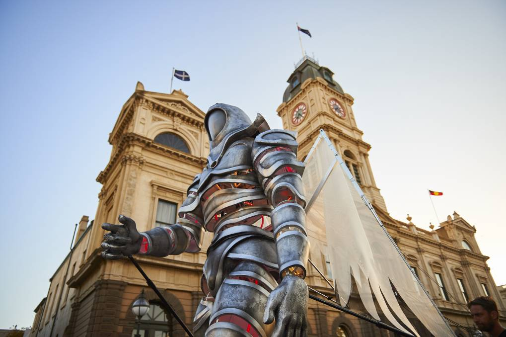 The White Knight Messenger strides past the Ballarat Town Hall during last weekend's festivities.