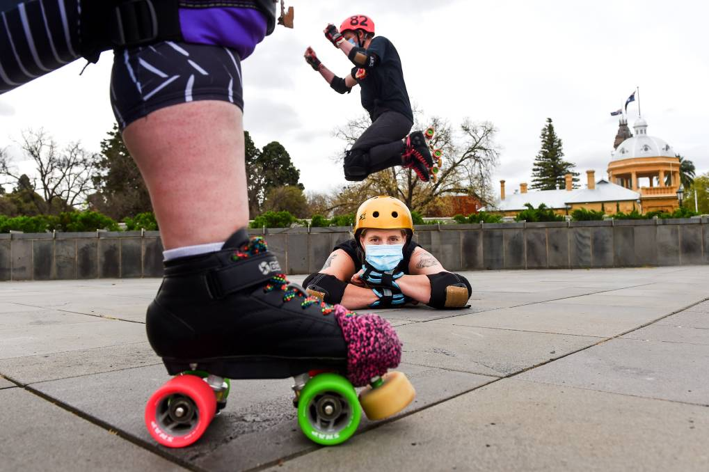 WHEELS IN MOTION: Larni Ham, Carolyn Spark and Belinda Penrose get creative with an outdoor skating opportunity. Picture: DARREN HOWE