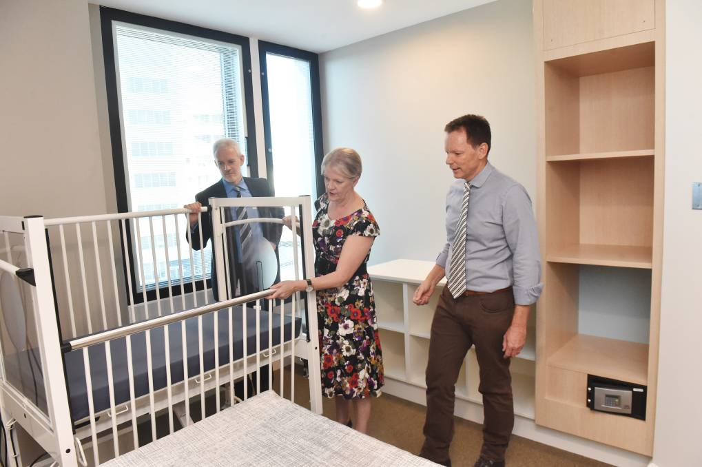 IN DEMAND: Bendigo Health psychiatric services executive director Phil Tune, Bendigo West MP Maree Edwards and Bendigo Health chairman Bob Cameron tour the parent-infant unit at the new hospital. Picture: DARREN HOWE