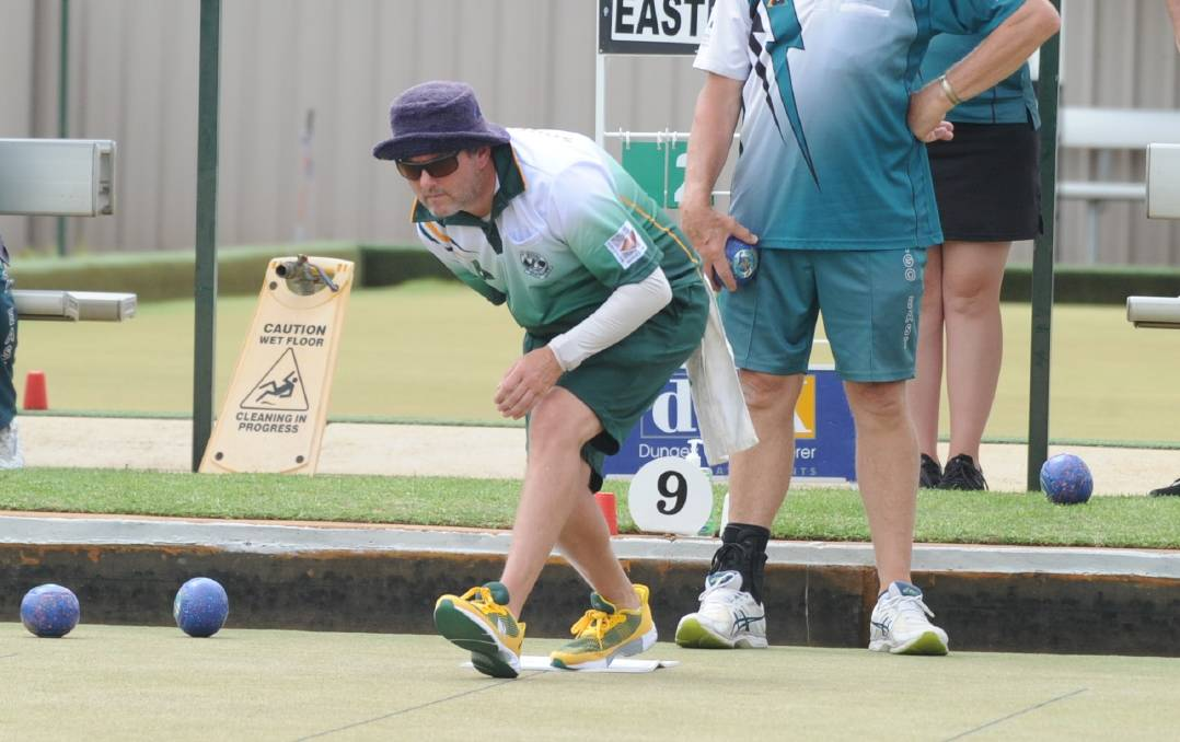 REIGNING PREMIERS AWAKEN: Daryl Rowley bowls for South Bendigo in Saturday's win over Bendigo East. Pictures: LUKE WEST