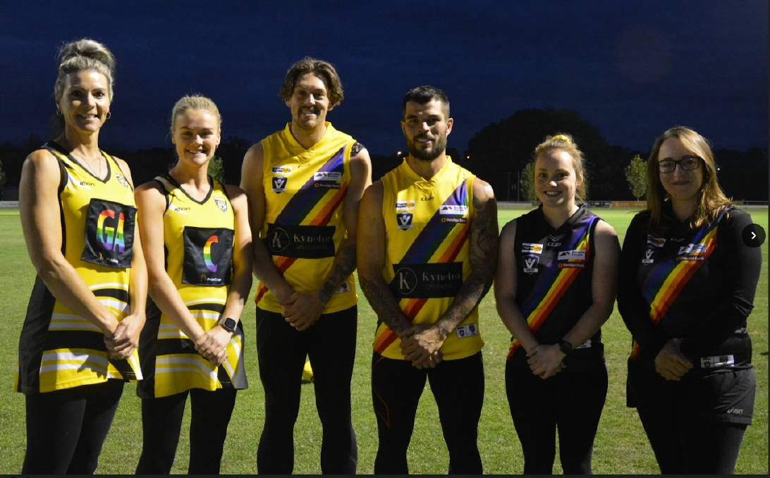 IMPORTANT MESSAGE: Kyneton footballers and netballers with their Pride Cup uniforms ahead of this Saturday's games against Eaglehawk. Picture: CONTRIBUTED