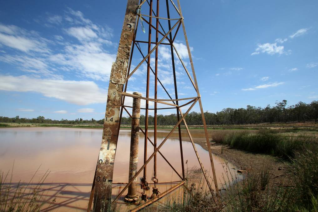 BONE DRY: A muddy puddle is all that is left of Wedderburn's Skinners Flat Reservoir. Pictures: GLENN DANIELS