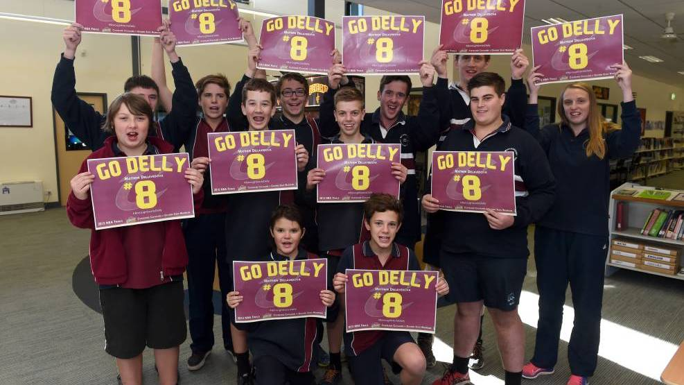Maryborough Education Centre students hold up posters supporting Matthew Dellavedova last year. Picture: JODIE WIEGARD