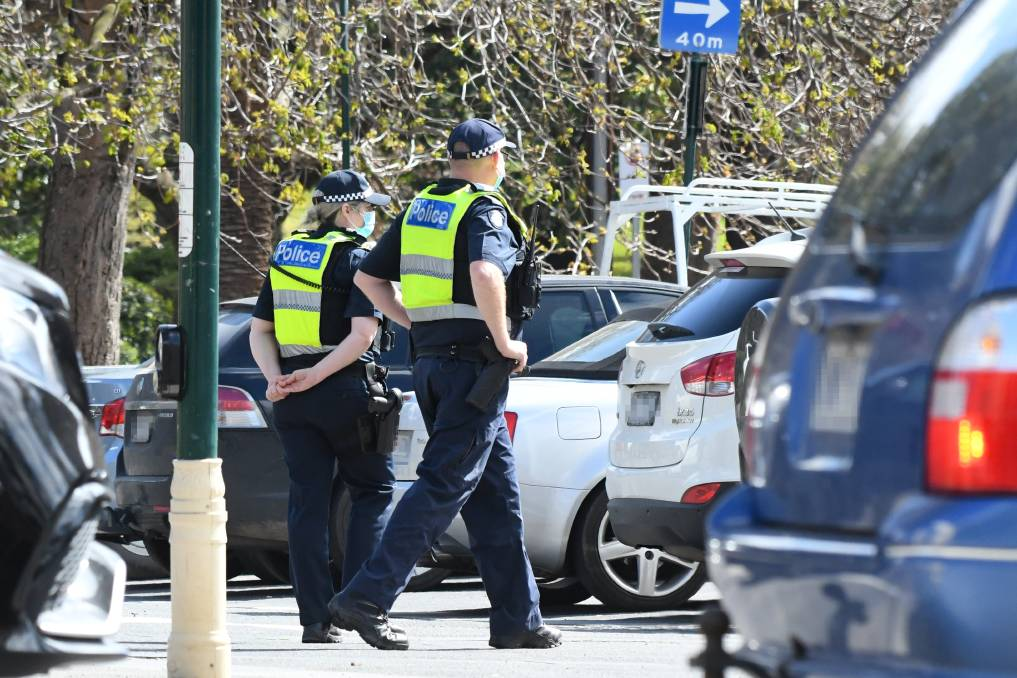 Police patrol the site of an apparent planned protest in Bendigo. Picture: NONI HYETT