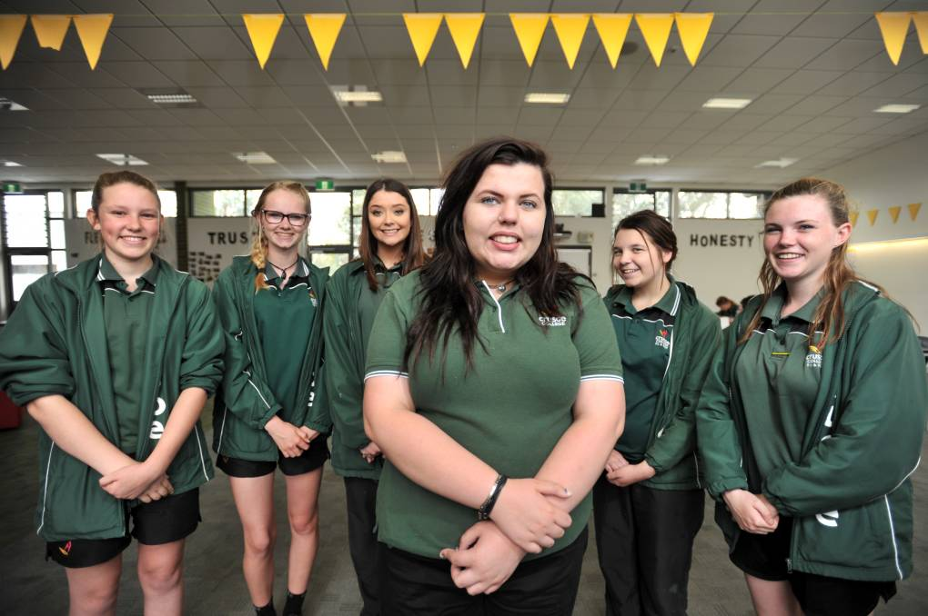 GOLDEN GIRLS: Crusoe College students Jess Maher, Bec Conway, Amanda Rodda, Ryllee Waite, Kiarah Witcombe and Jess Allen are giving their all to community projects. Picture: NONI HYETT