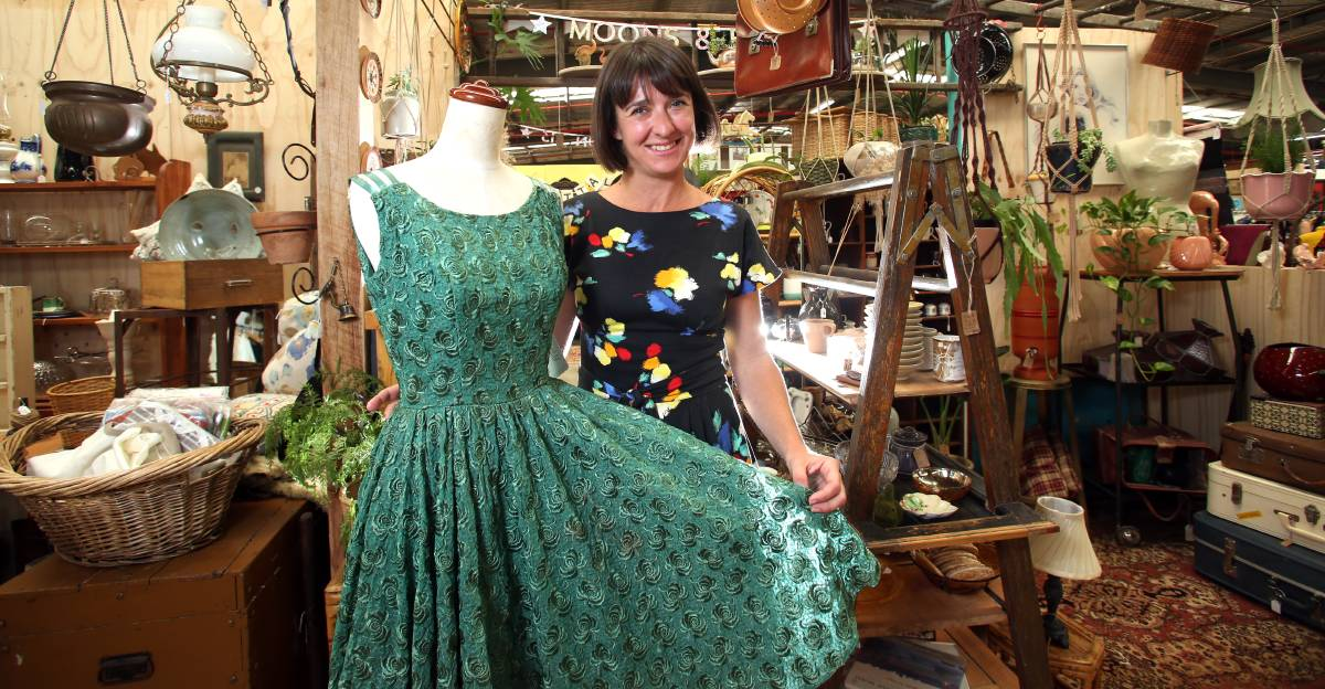NOSTALGIA: Castlemaine Vintage Bazaar manager Jane Goodrich with a vintage dress sourced from the United States. Picture: GLENN DANIELS