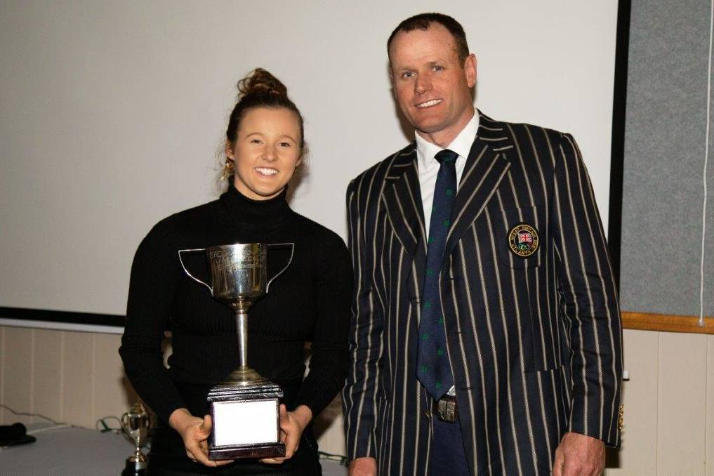 GOLDEN ROWER: Former British Olympic rowing coach Richard Hamilton presented the award to Livia Rosaia at the BRC's annual awards night. Rosaia won several gold medals at various events during the recent regatta season.