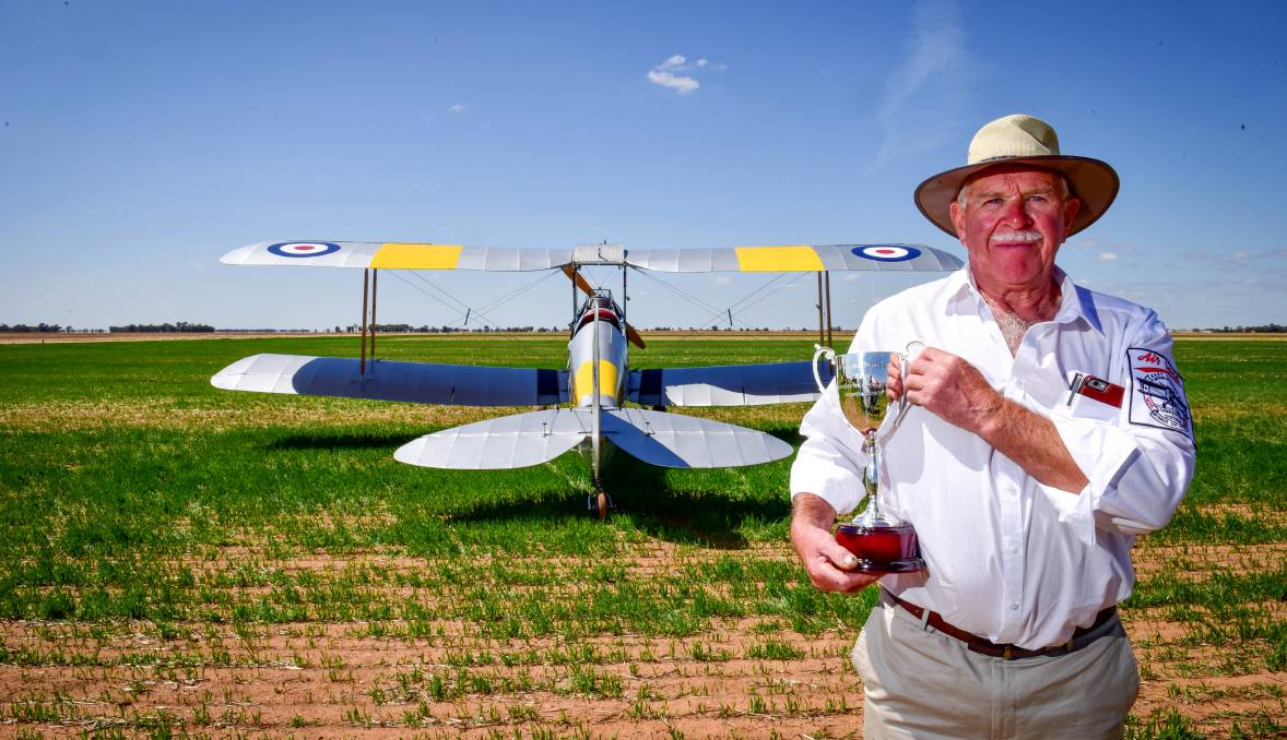 HISTORIC: Richard Evans with the cup for Serpentine Air race reenactment that was originally planned for March. Pictures: BRENDAN MCCARTHY