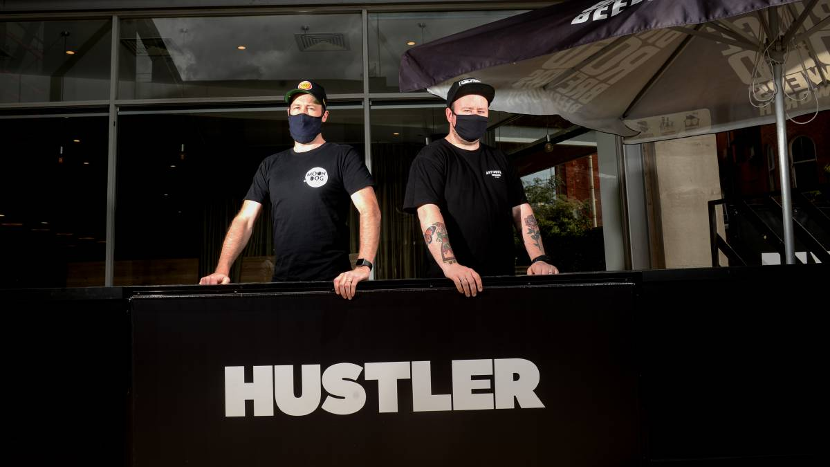 BURGER BOYS: Hustler owners Nick Horgan and Justin McPhail have expanded their hospitality operations. Picture: DARREN HOWE