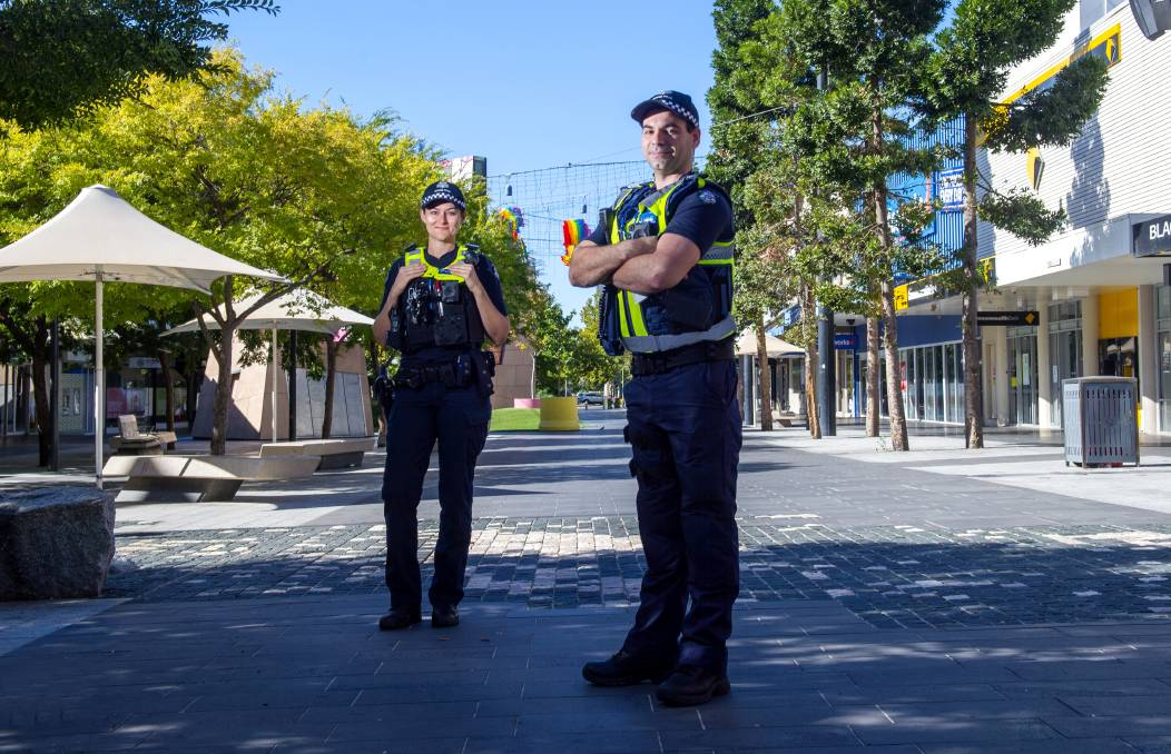 LOOKING OUT: Senior Constable Holly Lembke and Sergeant Mick Delaney in Hargreaves Mall on Tuesday. Picture: DARREN HOWE