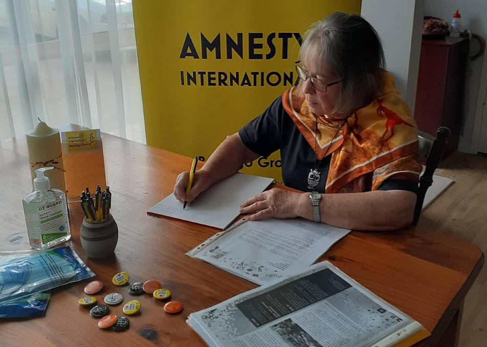 Bendigo Amnesty member Lee Griffiths writes to campaign against human rights abuses. Picture: SUPPLIED