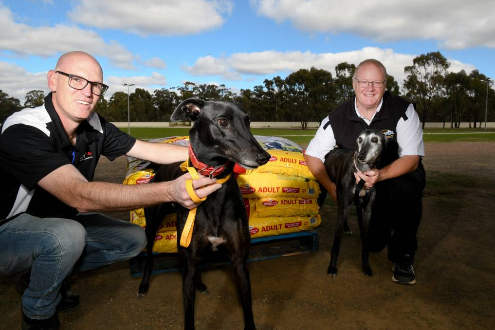 APPRECIATION: Greyhound Racing Victoria communication, media, events and marketing manager Brad Wiliams with Troy Harley and Sasha and Bayley. Picture: NONI HYETT