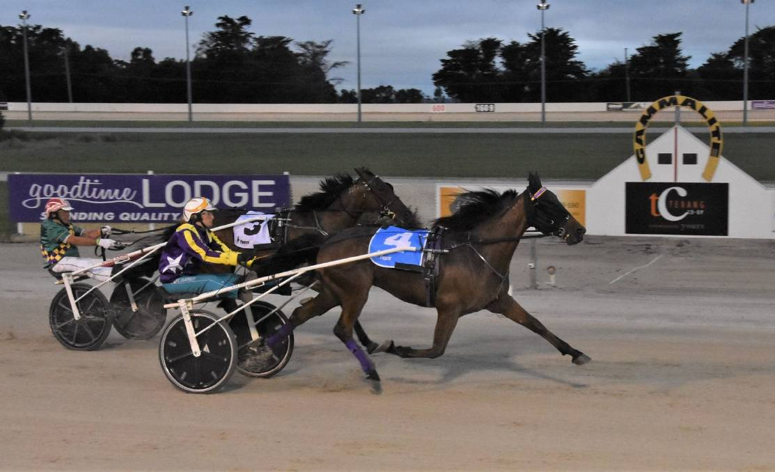ANOTHER CUP: Well Defined, driven by Ellen Tormey, sails past Robbie Royale (Chris Alford) to win the $25,000 Terang Trotters Cup. Picture: CLAIRE WESTON PHOTOGRAPHY
