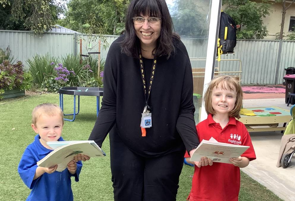Kathryn Rothacker with Eaglehawk Preschool students receiving picture books. Picture: supplied