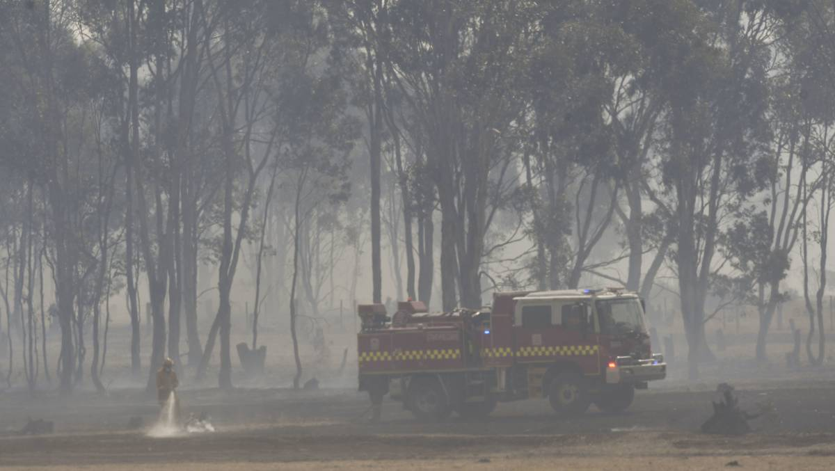 Firefighters battle a blaze in Huntly on Saturday. Picture: NONI HYETT