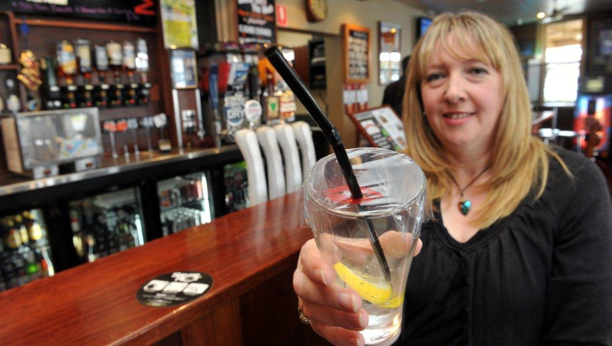 "INNOVATIVE: Michelle Hoffman has invented a plastic cover called ""Slip me not"" to protect drinks against drink spiking. Picture: Julie Hough"
